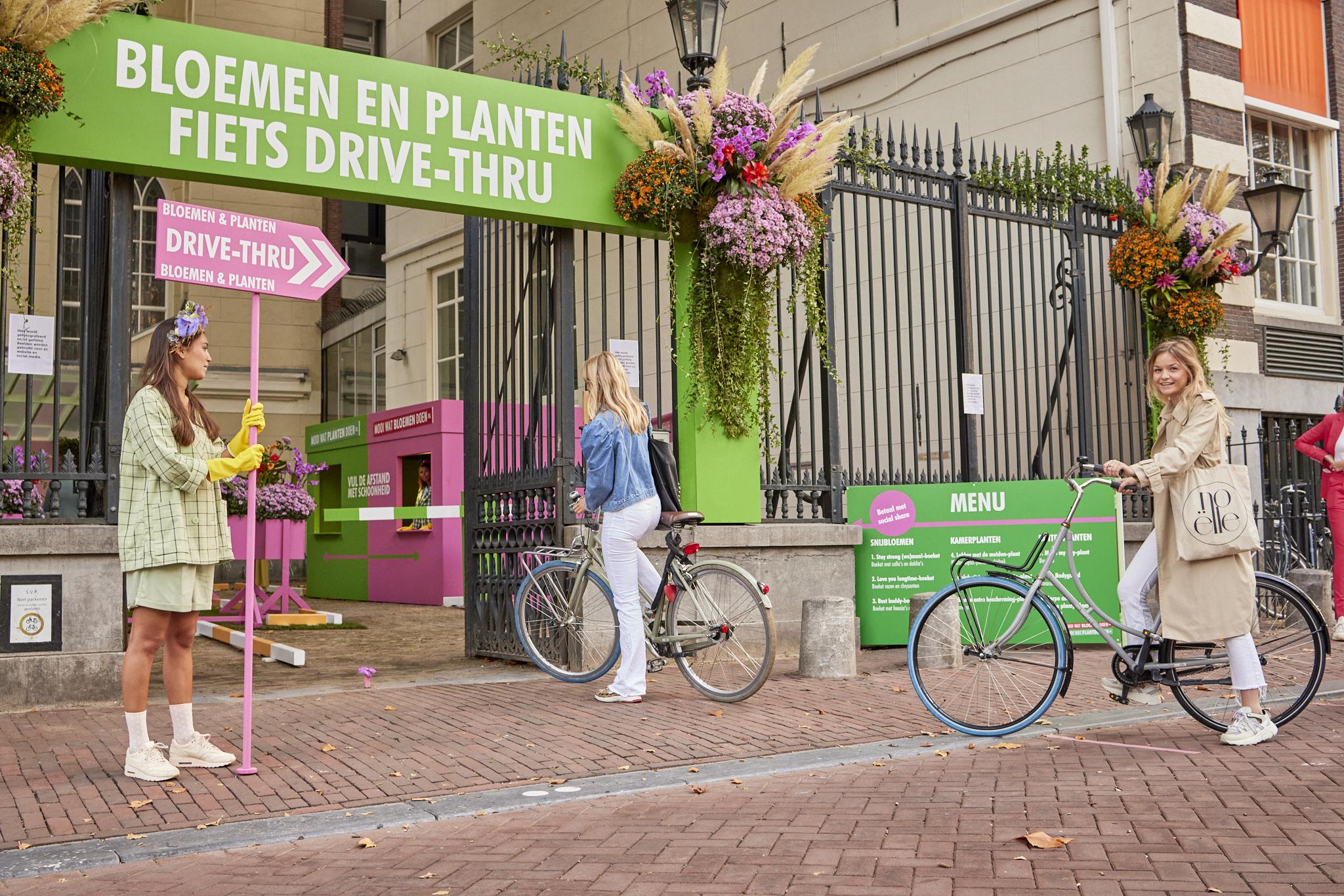 'Vul de afstand met schoonheid' Bloemen en Planten Fiets Drive_Thru in Amsterdam